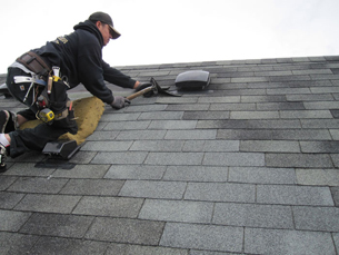Roofer Making Repairs to Roofing on a House in Federal Way, WA